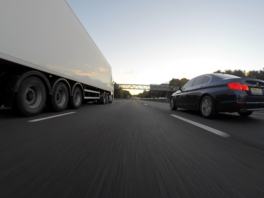 Car and truck driving on the half way | Astra Group Services