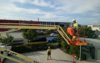Construction Workers driving a JLG lift | Astra Group Service