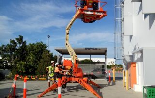 Construction Worker using a JLG lift | Astra Group Service