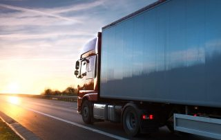 Truck driving on the highway | Astra Group Service