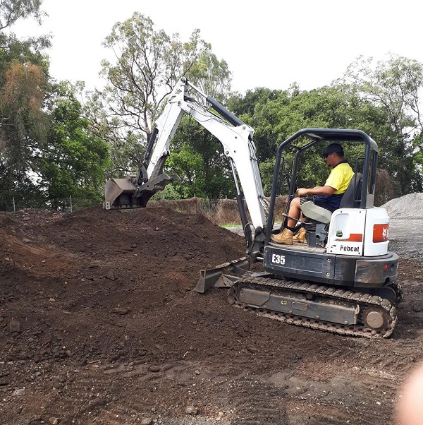 Construction worker driving an excavator | Astra Group Services