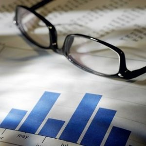 Image of graphs and reading glasses | Astra Group Services
