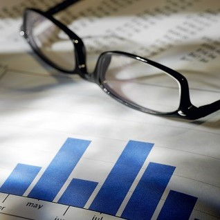 Image of graphs and reading glasses   Astra Group Services