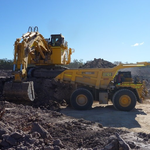 Image of excavator loading a mining dump truck | Featured image for Mining & Resources landing page.