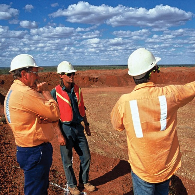 Tradies working on a landscape   Astra Group Services