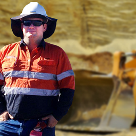 Tradie looking at the camera in a landspace background