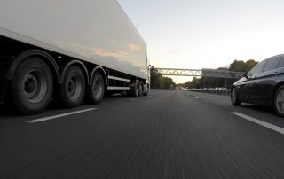 Vehicles on a main road | Astra Group Services