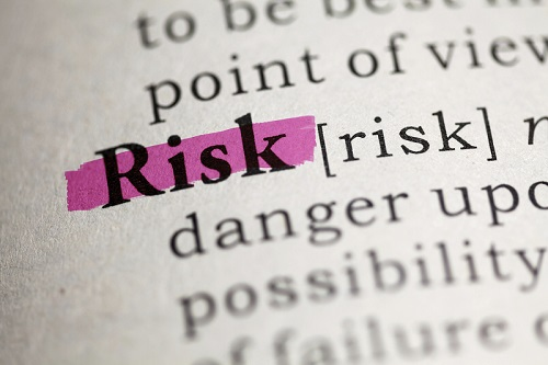 Book with 'risk' highlighted in purple | Featured image for Risk and WHS Management System Training.