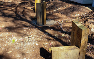 Wooden posts in ground | Featured image for AHC30916 Certificate III in Landscape Construction