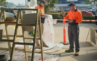 Image of tradesmen working at a site.